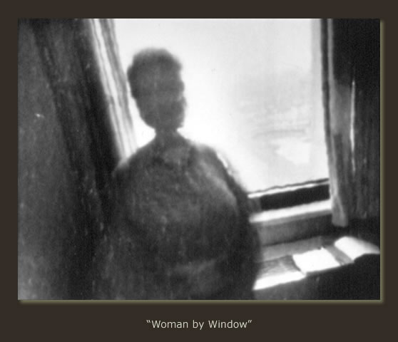 """Woman by Window"""